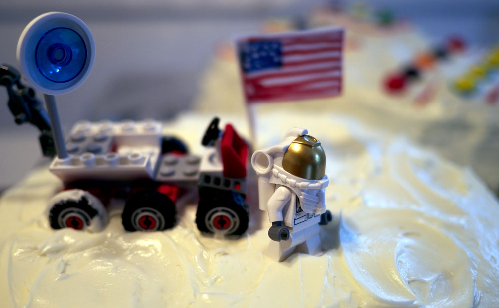 Lego astronaut on a birthday cake